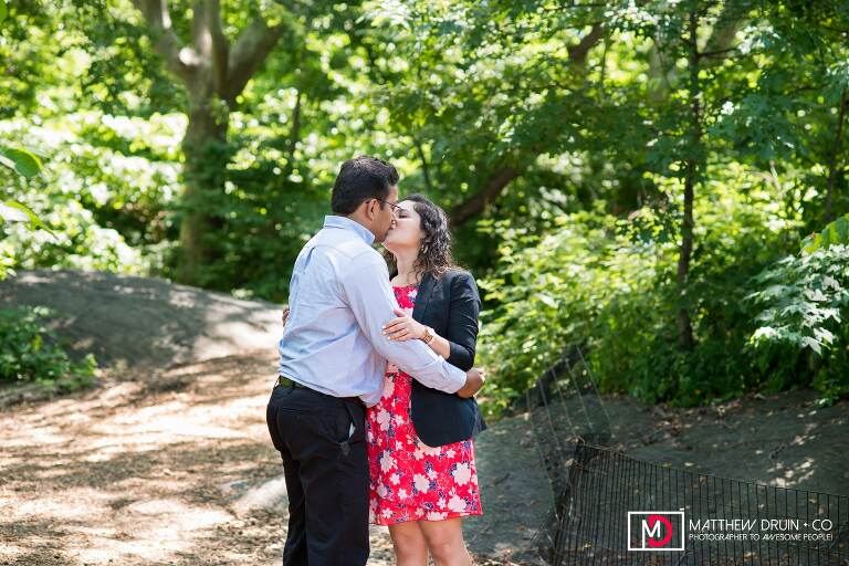 Bride and groom kissing at wedding proposal in Central Park during a New York City engagement