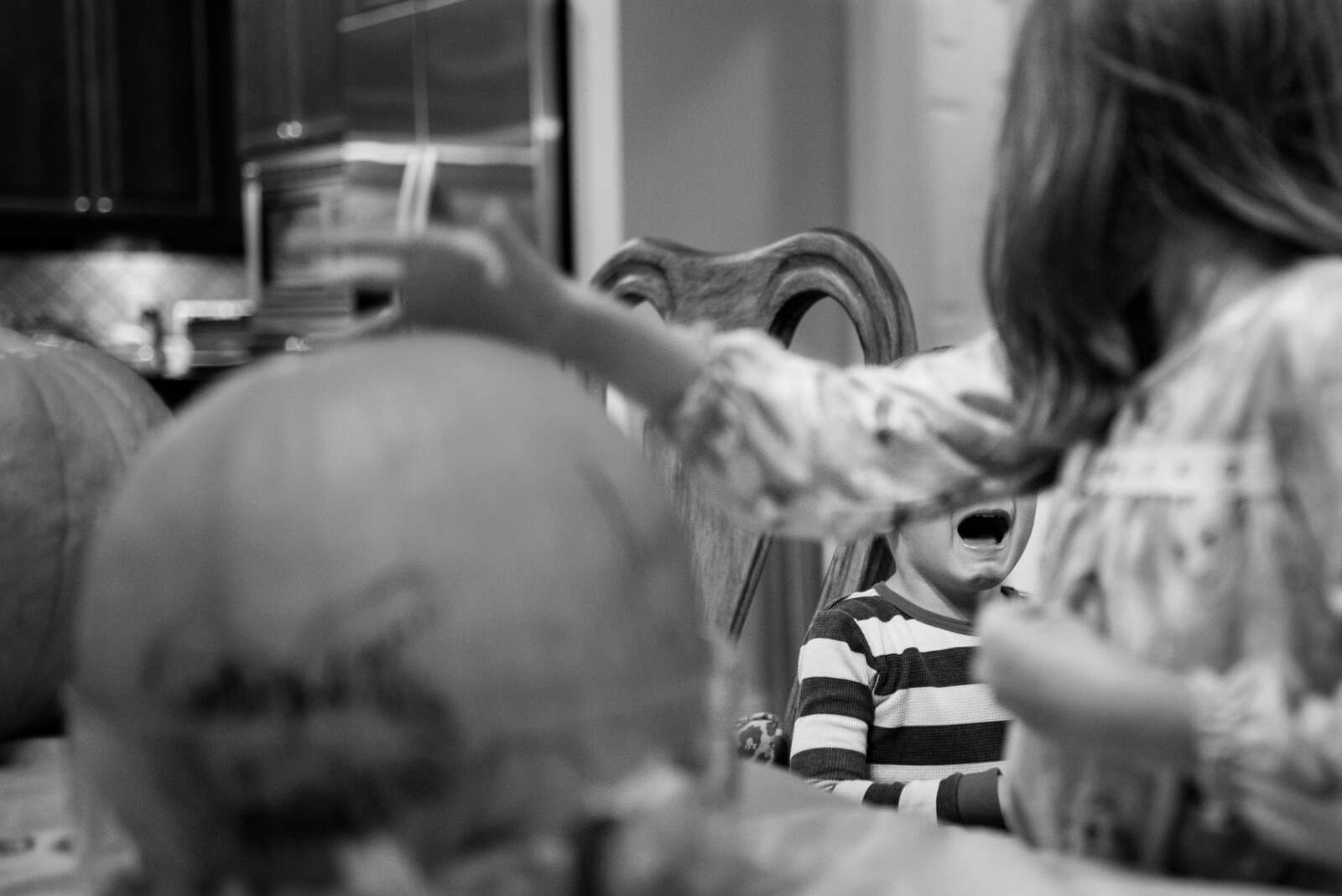 Boy crying as sister carves pumpkin during Atlanta Day In The Life family documentary