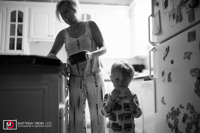 Mom making son's breakfast in the morning for first day of school