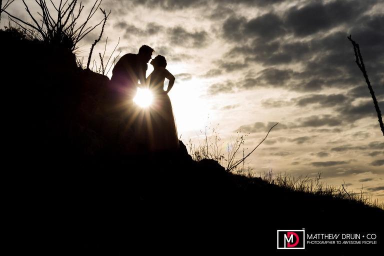 Bride and groom in the desert sunrise at destination Arizona wedding