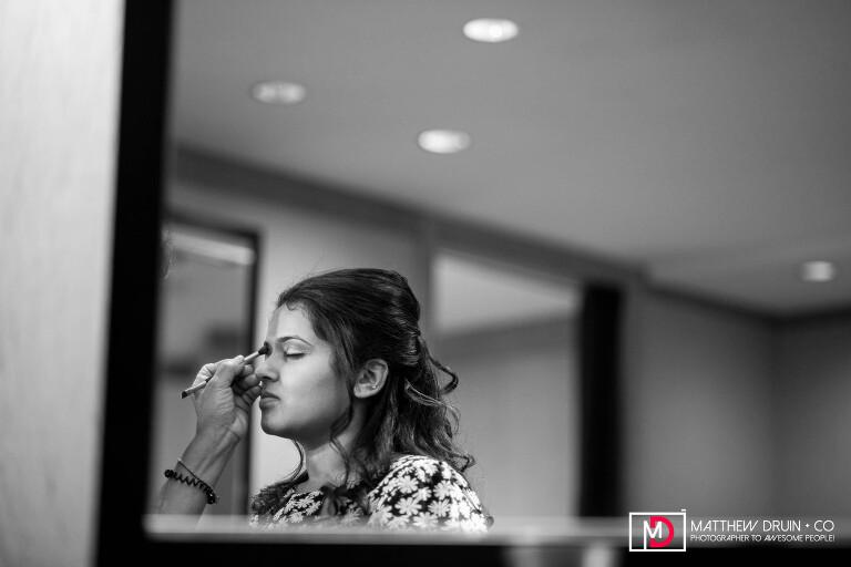 Bride getting makeup at destination New York fusion Indian wedding