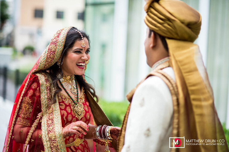 Bride and groom seeing each other at first look at destination New York fusion Indian wedding