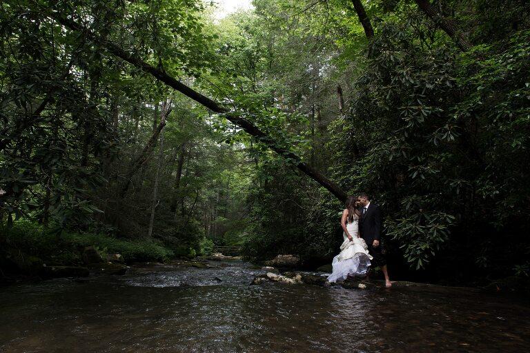 Bride and groom standing in river in Atlanta