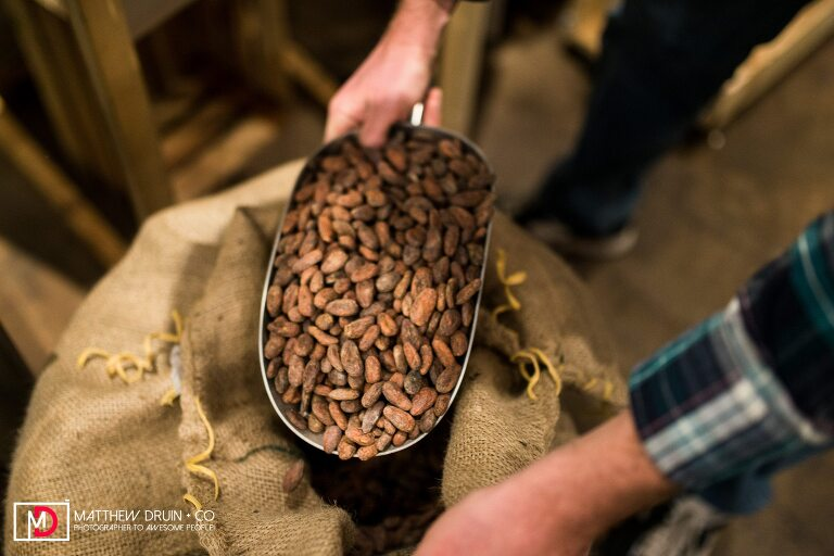 Cocolate beans being scooped for Atlanta chocolate store Xoxolatl at Krog Street Market