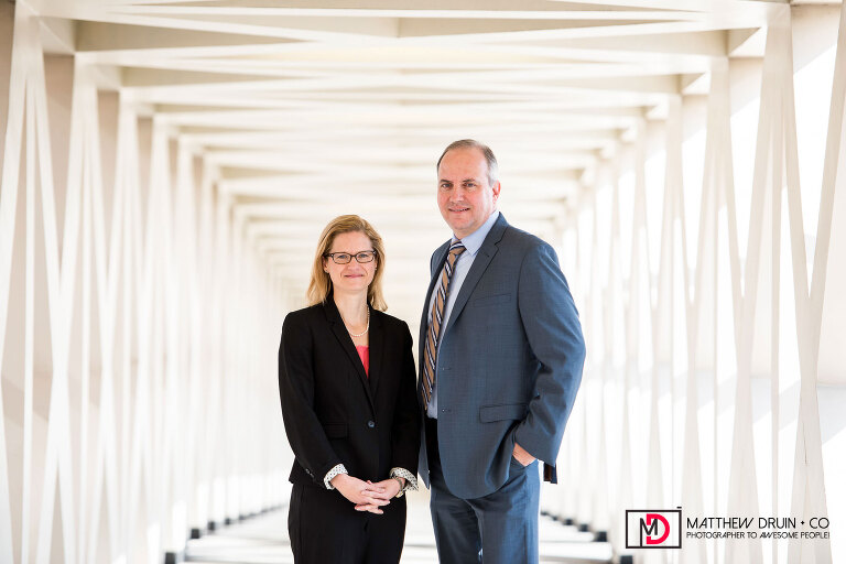 Richard E. Dunn and Lauren M. Curry in light-filled hallway for Georgia Environmental Protection for ACEC Engineering Magazine