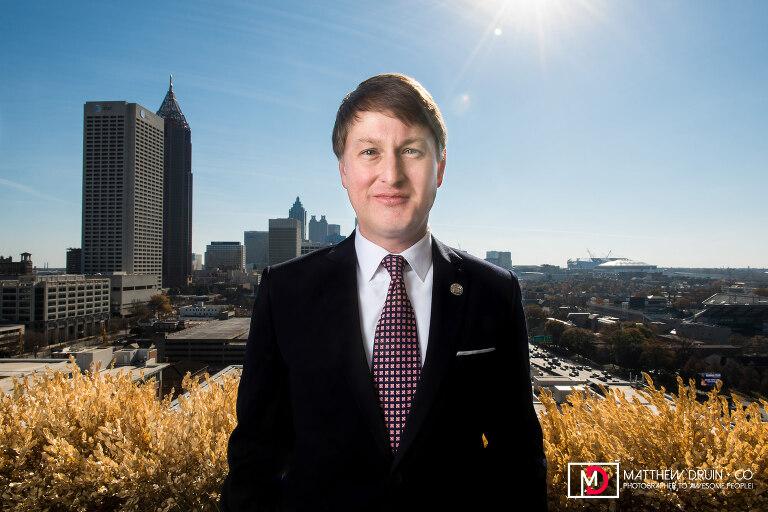 Georgia Commissioner Of Economic Development Pat Wilson standing with Atlanta skyline in the background