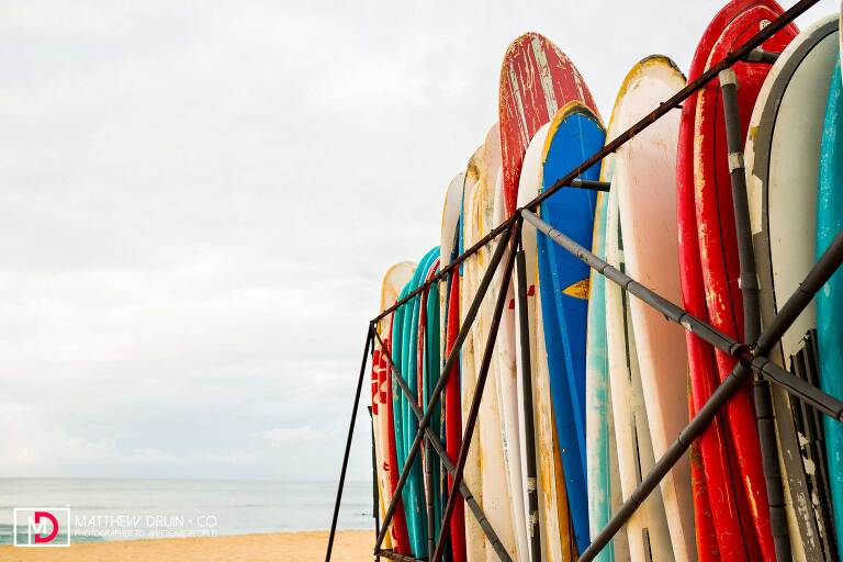 Surfboards standing on the beach in the morning at Honolulu Hawaii Wedding