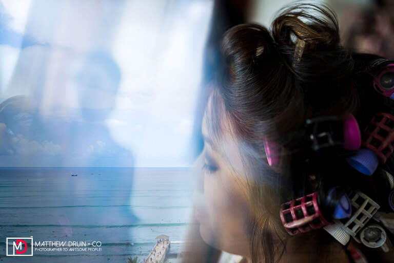 Reflection of ocean while bride gets her hair done at Honolulu Hawaii Wedding