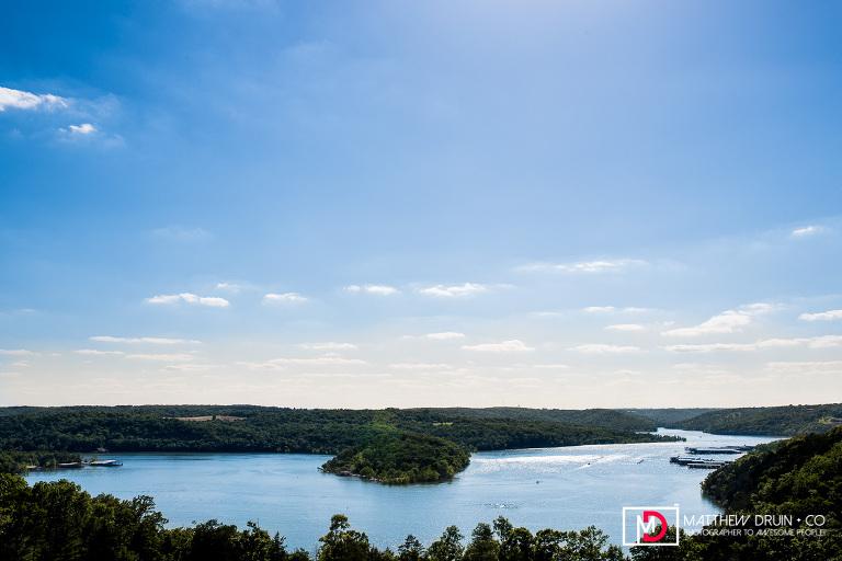 Landscape photo of lake with trees and blue sky at Big Cedar Lodge Branson Missouri wedding