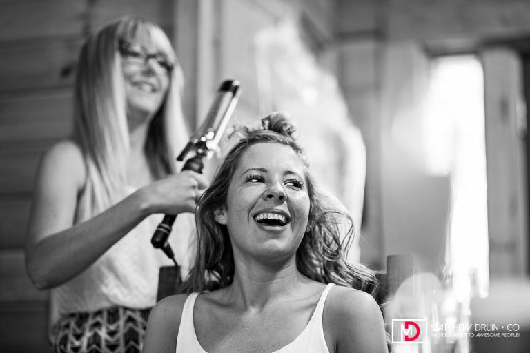 Bride laughing while getting hair done at Big Cedar Lodge Branson Missouri wedding