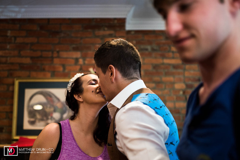 Engaged couple kissing in house before getting ready for their Washington DC wedding