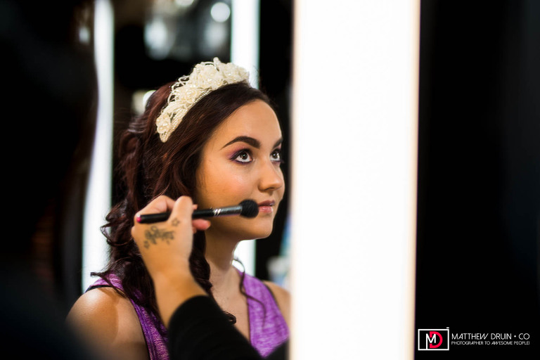 Bride getting makeup at Mac store in Union Station before her Washington DC wedding