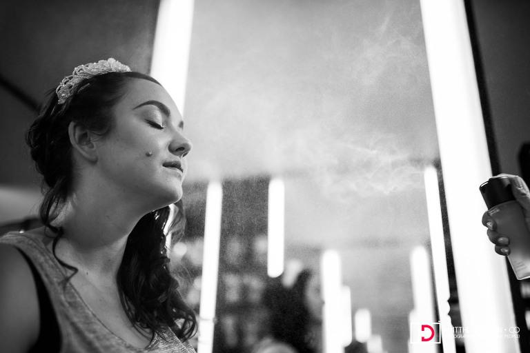 Makeup mist splashing bride while getting makeup at Mac store in Union Station before her Washington DC wedding