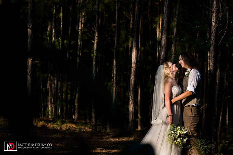 Bride and groom holding each other in woods during sunset Atlanta Georgia backyard wedding