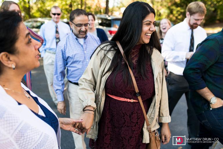 Bride holding mom's hand at Atlanta courthouse wedding and Hilton Marietta hotel reception