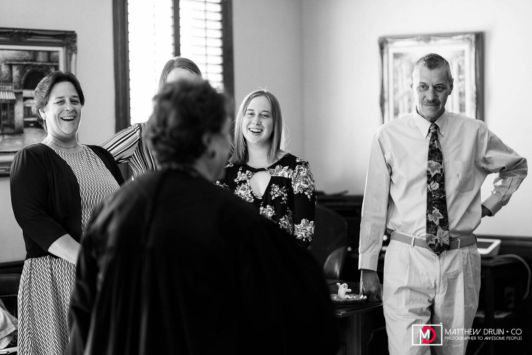 Judge talking to family about marriage during ceremony at Atlanta courthouse wedding