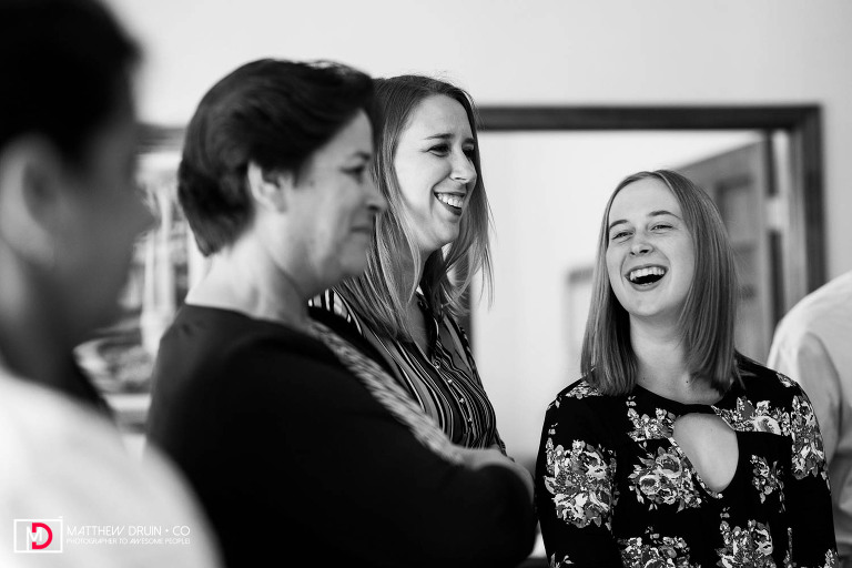 Groom sister's laughing during ceremony at Atlanta courthouse wedding and Hilton Marietta hotel reception