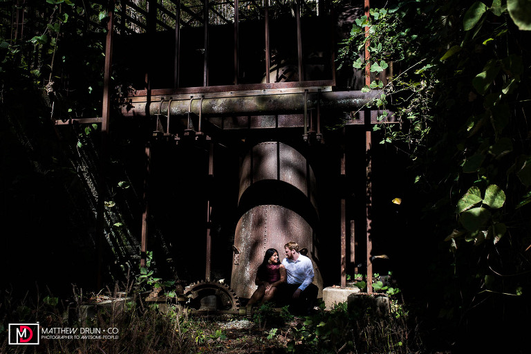 Bride and groom sitting on old mill in Roswell Georgia after Atlanta courthouse wedding