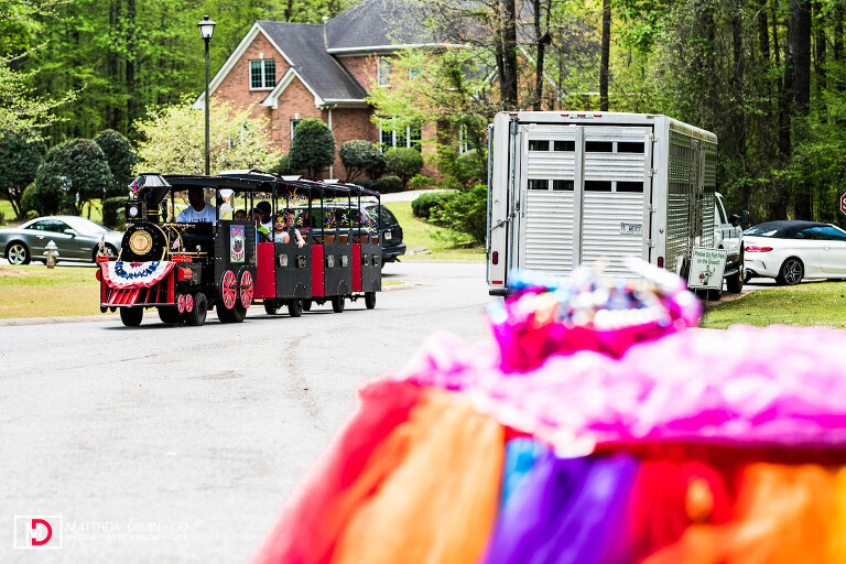 Train bring guests to 35th unicorn themed birthday party