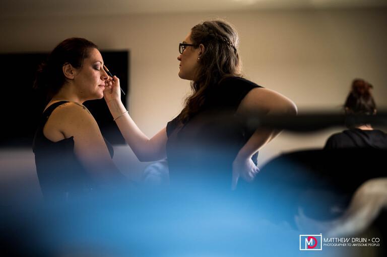 Bridesmaid having makeup done for Michigan State University Grand Rapids wedding