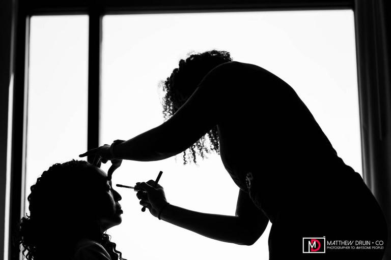 Silhouette of bride having makeup done for Louisville wedding from Atlanta wedding photographer Matthew Druin
